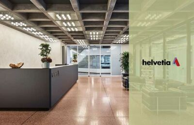 Entrance area in modern business building with lounge with helvetia logo